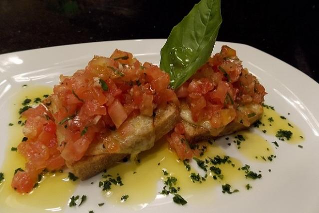 Bruschetta com mussarela artesanal e confit de tomate